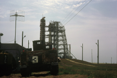 Figure Page 107-- The wire escape system from the top of Pad 39A. In case of emergency, the astronauts would jump into a gondola, which would speed down the wires and bring the men to armored personnel carriers to evacuate the area. This photo was taken on July 14, 1969 within 2,000 feet of the Apollo 11 Saturn V.