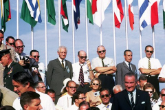 Figure Page 133--     One of the VIP grandstands at the Kennedy Space Center on July 16, 1969 just before the launch of Apollo 11. President Lyndon Johnson is at lower right, former NASA Administrator James Webb seated at lower center, and Peace Corps Director Sargent Shriver at lower left.