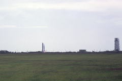 Figure Page 135--    A blue dot of flame is seen at the base of the Apollo 11 Saturn V just after ignition on Pad 39A at the Kennedy Space Center.
