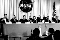 Figure Page 25--  The Mercury 7 astronauts are introduced at a press conference in Washington April 9. 1959.  (from left)  Deke Slayton, Alan Shepard, Wally Schirra, Gus Grissom , John Glenn, Gordon Cooper and Scott Carpenter.